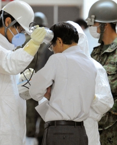 A man is tested for radiation in Fukushima