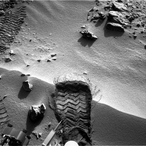 "NASA's Mars rover Curiosity cut a wheel scuff mark into a wind-formed ripple at the ""Rocknest"" site to examine the particle-size of the ripple. For scale, the width of the wheel track is about 16 inches (40 centimeters)."