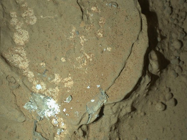A Martian rock illuminated by white-light LEDs is part of the first set of nighttime images taken by the Mars Hand Lens Imager camera.
