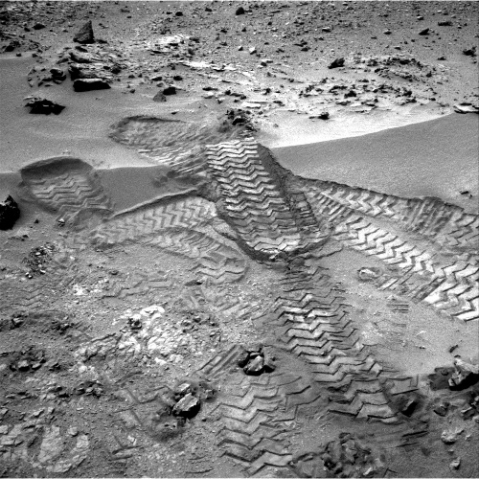 Curiosity's tracks was taken by Navcam onboard NASA's Mars rover Curiosity, on Nov. 18 2012.