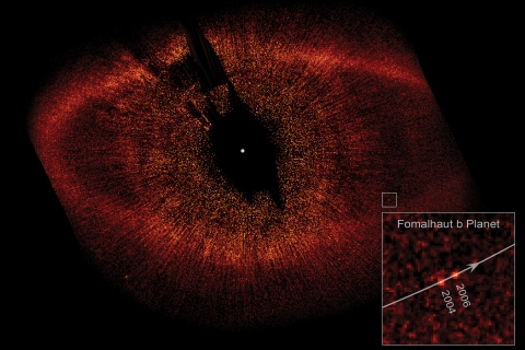 A Hubble image of the dust cloud surrounding the star Fomalhaut, with the planet Fomalhaut B indicated