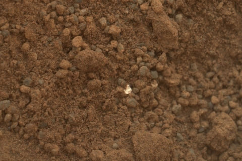 A millimeter-size reflective fleck discovered by Curiosity in the Martian soil
