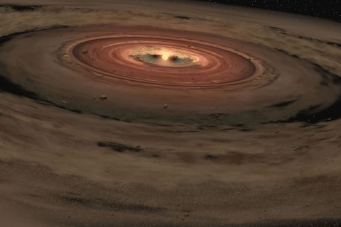 image: This artist's concept shows a brown dwarf surrounded by a swirling disk of planet-building dust.