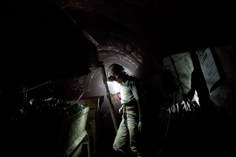 image: A worker labors to develop a new coal mine shaft in Shanxi Province, China, March 24, 2011.