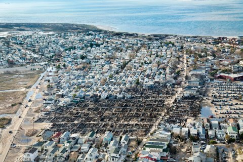 image: The Breezy Point neighborhood at the tip of the Rockaway Peninsula in Queens, N.Y., where more than 100 homes were consumed by fires during Superstorm Sandy.