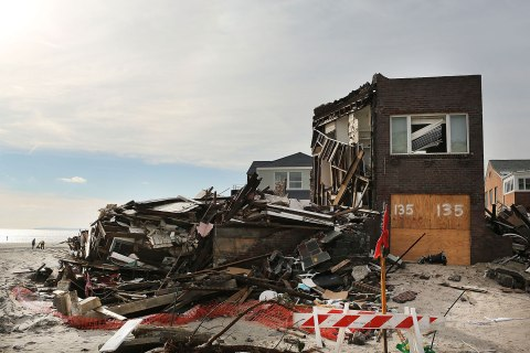image: A destroyed home sets along the beach in the Belle Harbor neighborhood in the Rockaways in Queens, N.Y., Jan. 2, 2013.