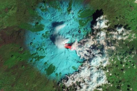 Italyís Etna Volcano is seen erupting in this false-color NASA handout image