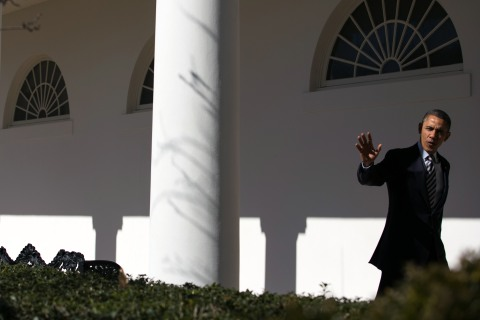 President Barack Obama walks down the colonnade at the White House