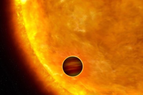 An artist's impression of a Jupiter-sized exoplanet passing in front of its parent star.