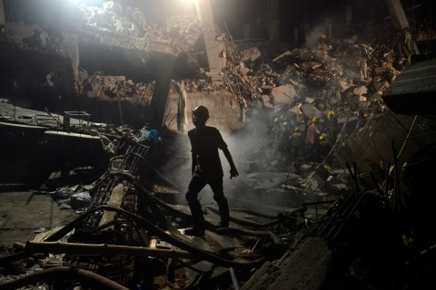 A worker at the site of the garment factory building that collapsed near Dhaka, Bangladesh, on April 29, 2013.