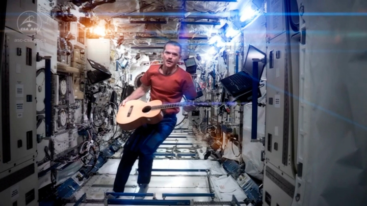 "Canadian astronaut and International Space Station (ISS) Commander Chris Hadfield performs his zero-gravity version of David Bowie's hit ""Space Oddity"" in this video still. The video was released on YouTube on May 12, 2013."