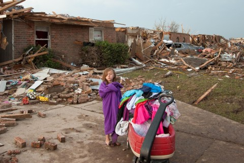 Corrie Griffith stands in the driveway of her family's home after a deadly tornado struck Moore, Okla., on May 20, 2013.