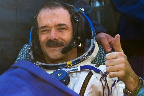 Canadian astronaut Chris Hadfield gestures after the Russian Soyuz space capsule landed some 150 km (90 miles) southeast of the town of Zhezkazgan, in central Kazakhstan