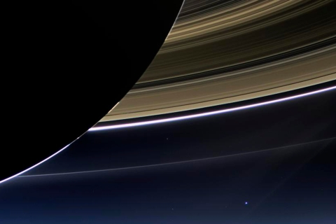 Saturn's rings and our planet Earth and its moon are seen in this NASA handout image