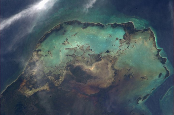 A view of the sea, sand and clouds in the Caribbean,taken by Astronaut Luca Parmitano of the Volare Mission from the International Space Station, on Aug. 13, 2013.