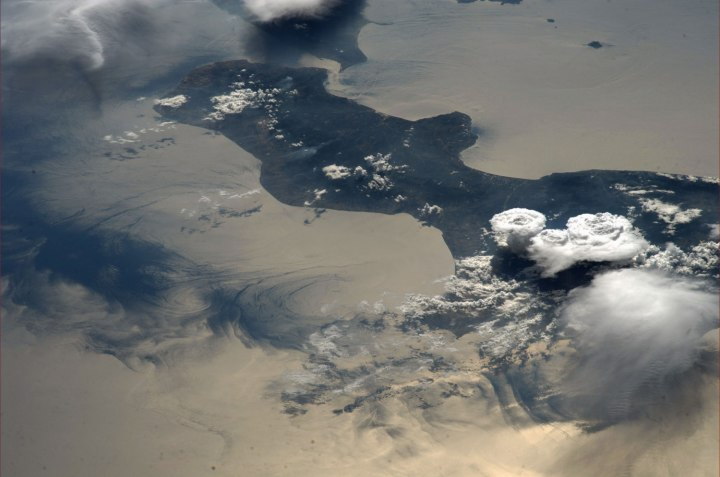 A view of summer storms and sea currents in Calabria, Italy, taken  by Astronaut Luca Parmitano of the Volare Mission from the International Space Station, on Aug. 22, 2013.