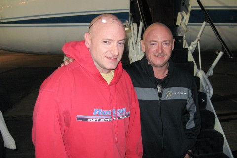 From left: Expedition 26 Commander Scott Kelly is reunited with his twin brother, Mark Kelly on March 17, 2010, following a flight back to Ellington Field, Houston from Kustanai, Kazakhstan.
