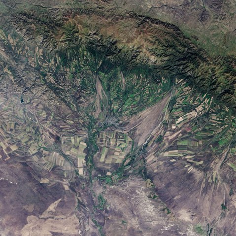 September 22, the autumnal equinox, marks the beginning of fall in the Northern Hemisphere, but the fall harvest begins early in the harsh continental climate of eastern Kazakhstan. By September 9, 2013, when the Operational Land Imager (OLI) on the Landsat 8 satellite acquired this image, several fields were already harvested and bare. Others were dark green with pasture grasses or ripening crops. The fields fill the contours of the land, running long and narrow down mountain valleys and spreading in large squares over the plains.