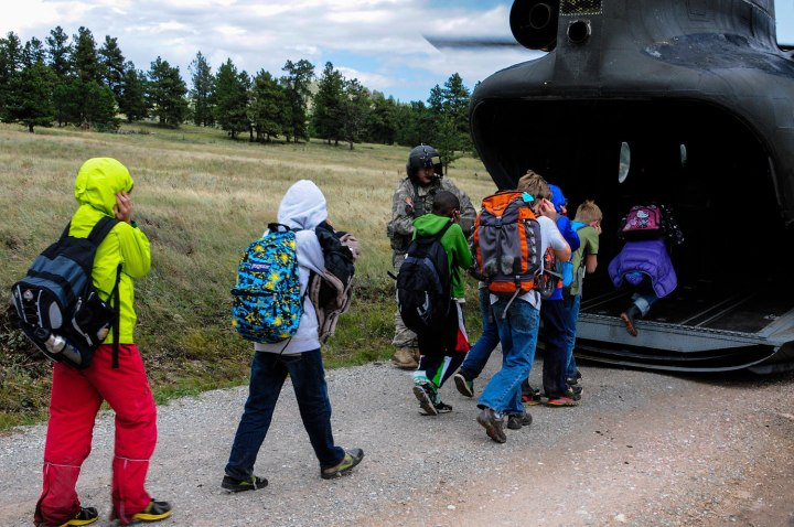 Children from Cal-Wood Education Center in Jamestown, Colo., board a rescue helicopter flown by the U.S. Air National Guard after severe flooding shut down major roads leading out of town in this Sep. 14, 2013.