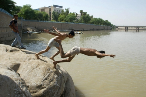 Young Arab Iranians swim in the mighty K
