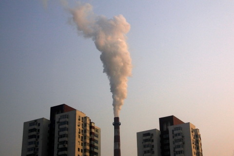 A chimney of a coal burning heating system for apartment blocks billows smoke in central Beijing