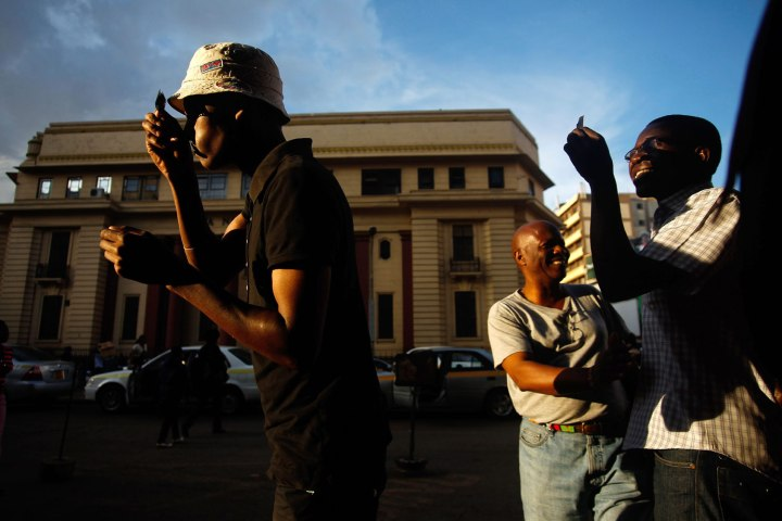 Kenyans observe the partial solar eclipse in the streets of Nairobi, on Nov. 3, 2013.