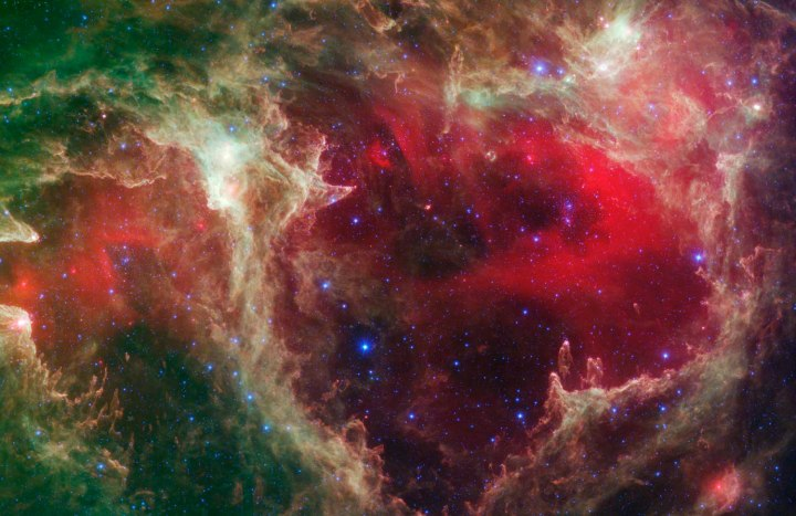 Generations of stars, seen in an infrared portrait from NASA's Spitzer Space Telescope,  in the star-forming region, W5.