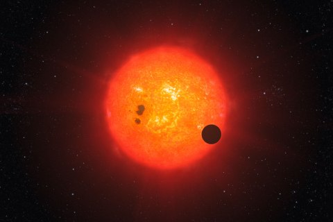 This artist's impression shows how the newly discovered super-Earth surrounding the nearby star GJ1214 may look.
