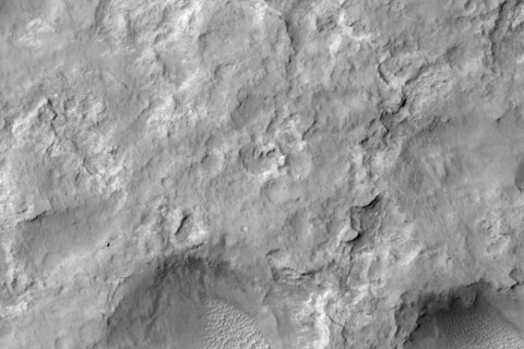NASA's Curiosity Mars rover and tracks left by its driving appear in this portion of a Dec. 11, 2013