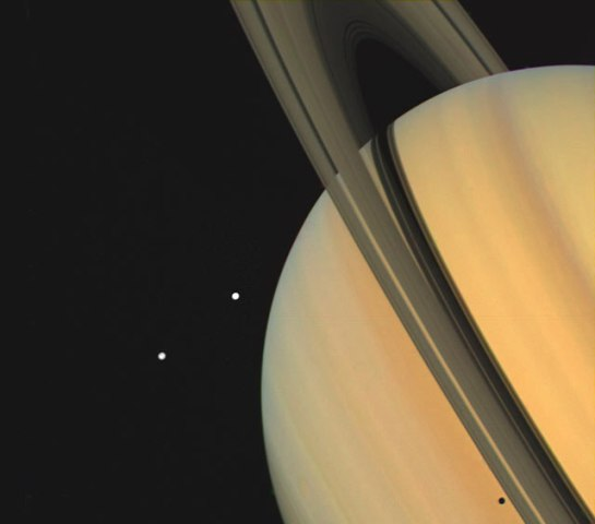 Saturn with Tethys and Dione, Voyager I, Nov. 1980.