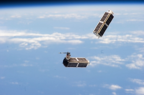 A set of NanoRacks CubeSats photographed by an Expedition 38 crew member after the deployment by the Small Satellite Orbital Deployer (SSOD).